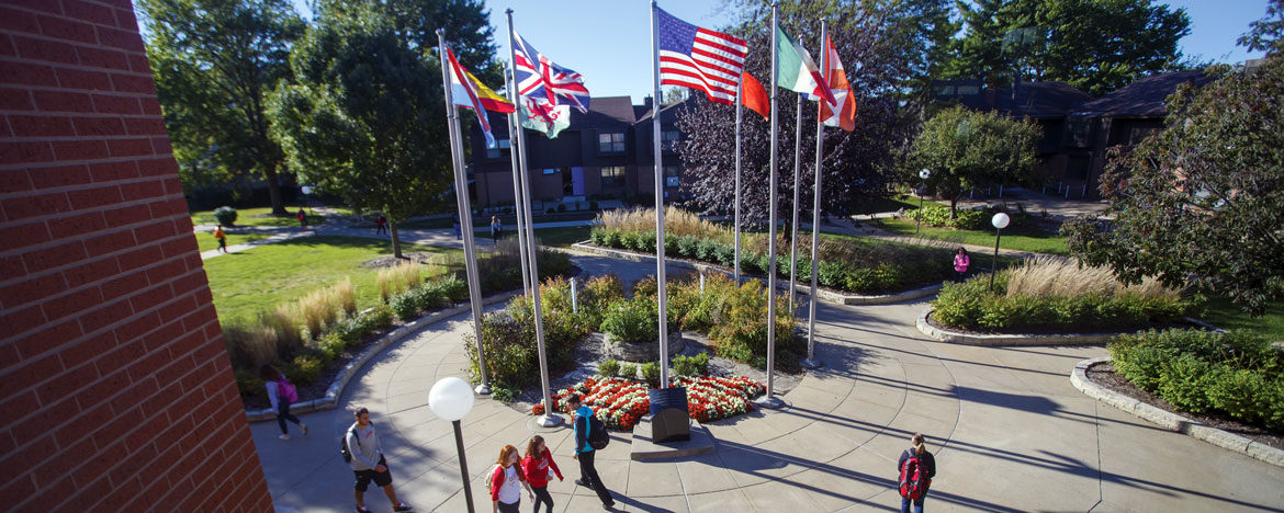 Photo of international flags outside the Weller Center for Business and International Studies.