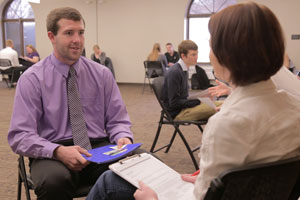 Student interviewing with a potential employer at the spring Interview Blitz