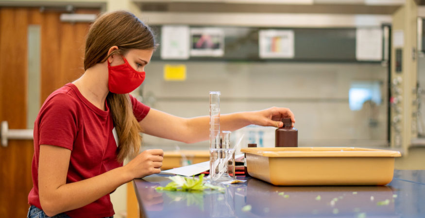 A student participates in an event during STEM Camp Visit Day.