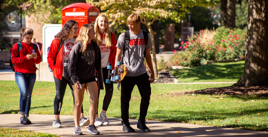 Students walking together through campus