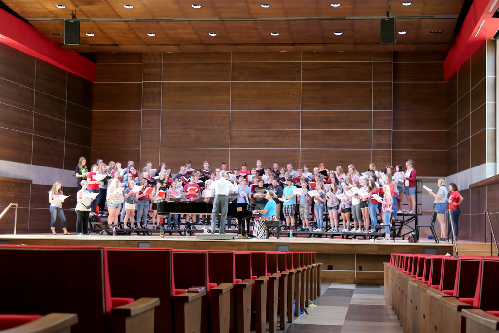 A cappella choir rehearsing in Douwstra Auditorium