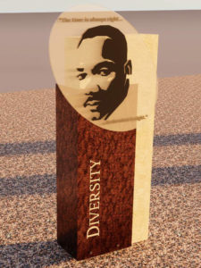 Rendering of the Diversity history marker, portraying the Reverend Dr. Martin Luther King with his words inscribed.