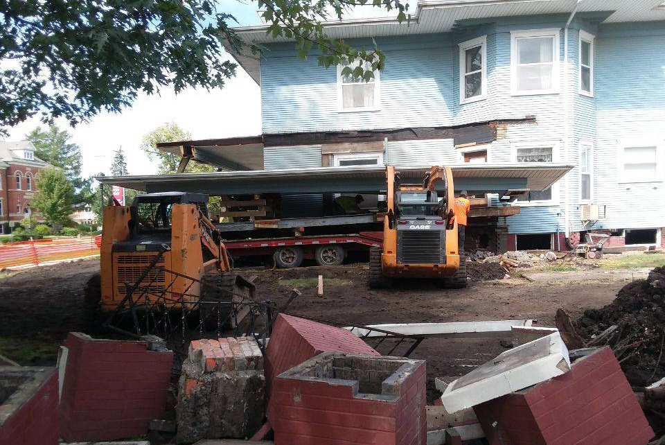 Pieces of the side porch brick columns have been removed from the house.