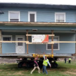 Owner and moving crew celebrate as Boardwalk House has arrived at its destination.